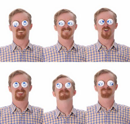 satirist: Details of  facial expressions, young man with toys on his eyes