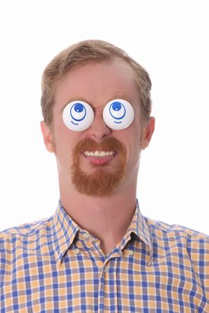 Very funny young man with toys on his eyes