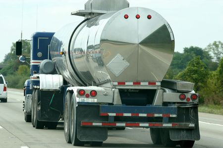 Fuel Tanker, truck driving on  on highway photo