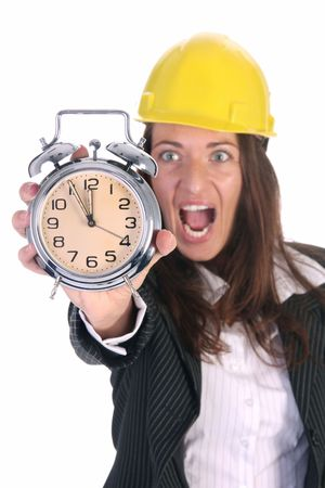 young businesswoman confused looking at clock alarm photo