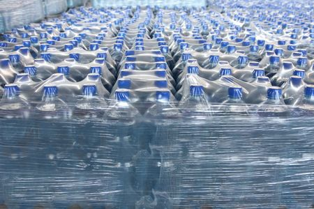 engarrafado: detail of stack bottled water in industry Banco de Imagens