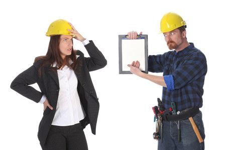 quarreling between angry businesswoman and construction worker wonderfully looking on document  photo