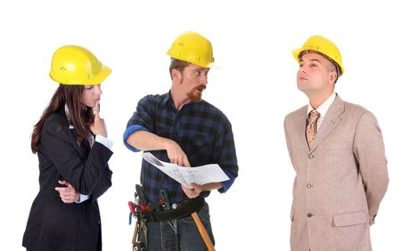 journeyman: business team talk with architectural plans on white background Stock Photo
