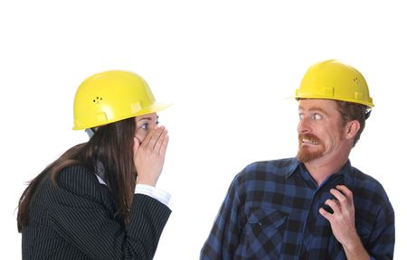 tattle: businesswoman gestures telling something to afraid construction worker on workplace