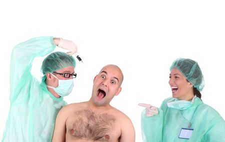 aggressive surgeon injecting a scare patient and laughing healthcare worker  photo