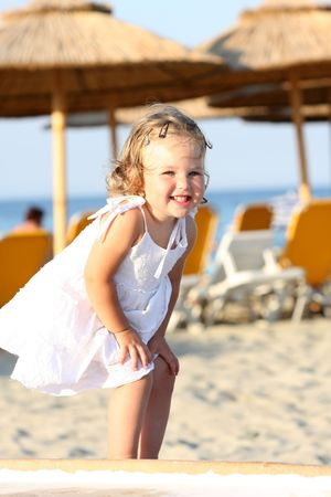 Beauty a little girl at beach in the sea  Stock Photo