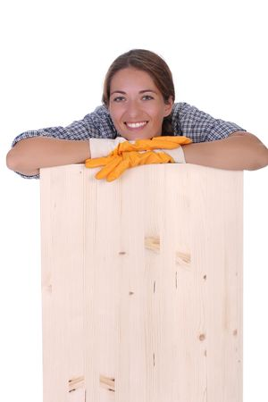 servicewoman: woman carpenter holding wooden plank on white background