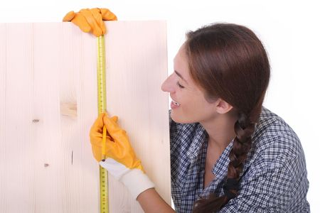 woman carpenter with wooden plank and measuring tape Stock Photo - 3479958