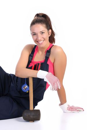 servicewoman: woman with black rubber mallet on white background  Stock Photo