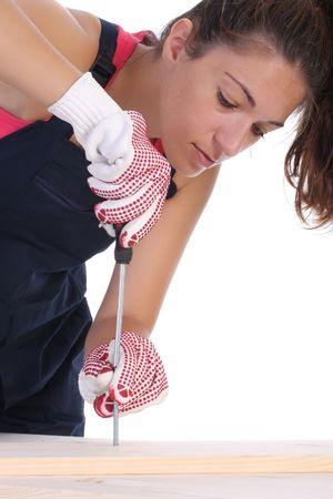 servicewoman: woman carpenter at work on white background
