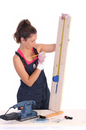 woman carpenter with wooden plank and measuring tape Stock Photo - 3591691