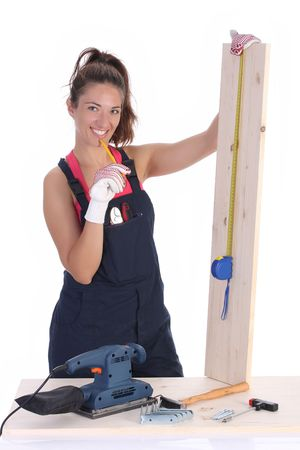 woman carpenter with wooden plank and measuring tape photo
