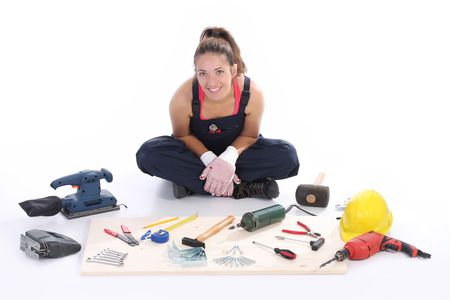 woman carpenter with work tools on wooden plank photo