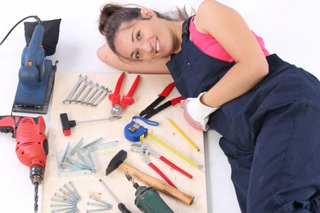 woman carpenter with work tools on wooden plank Stock Photo - 3591693