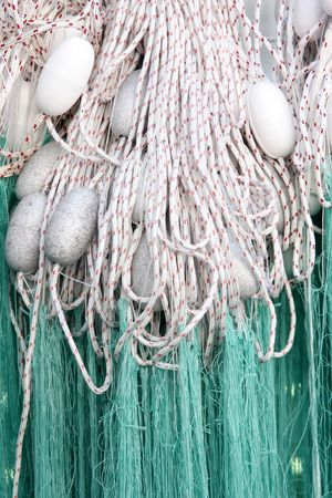 fishing net with floats in close up photo