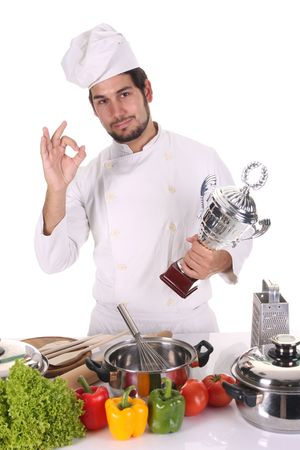 young chef with trophy on white background