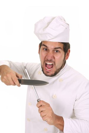 Mad chef sharpening a knife with sharpener photo