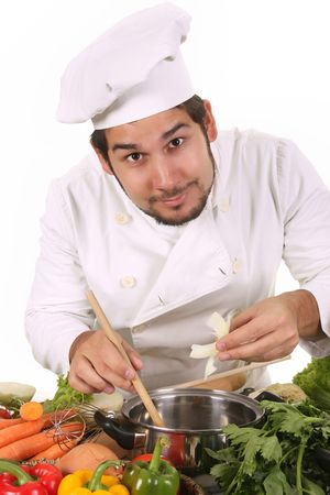 dinner wear: young chef preparing lunch on white background