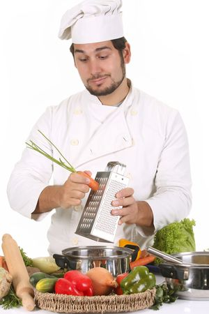 young chef preparing lunch and cutting carrot with stainless grater Stock Photo - 3834281