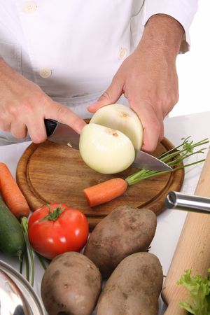 chef preparing lunch and cutting onion with knife Stock Photo - 3843392