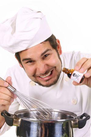 veneno frasco: joven chef la preparaci�n de la comida con veneno botella