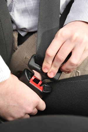 safety belt: details of hands putting on safety belt