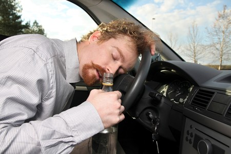 sleepiness: tired driver sleeps in a car Stock Photo