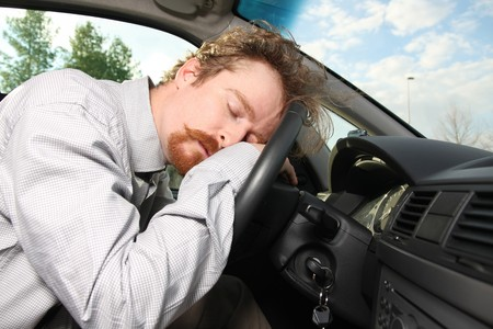 sleepy: tired driver sleeps in a car Stock Photo