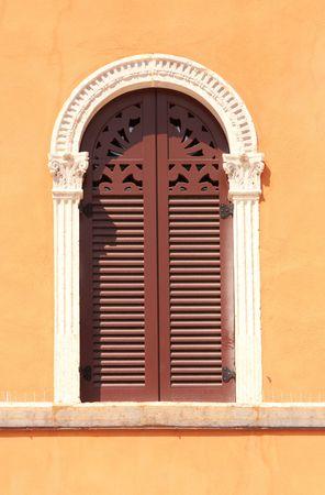 historic place: beautiful windows and a orange wall in piazza Signoria, Verona, Italy Stock Photo