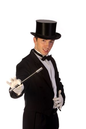 young magician performing with wand on white background Stock Photo - 5072297