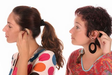 Two woman putting hearing aid into ear  Stock Photo