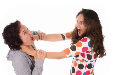 Two young woman fighting over a white background