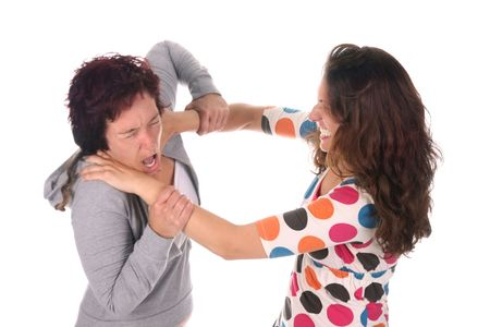 girl fighting: Two young woman fighting over a white background