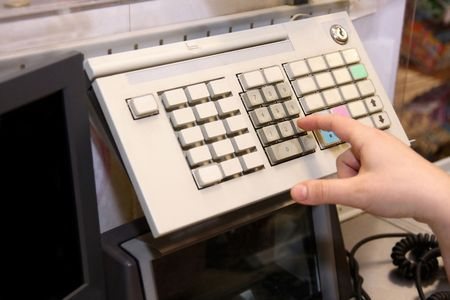 Typing to the cashier at the supermarket Stock Photo - 5406691