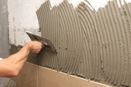 details of trowel spreading mortar for ceramic tile
