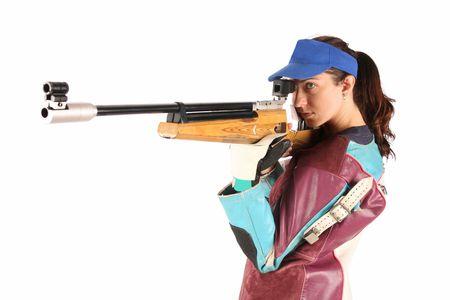 rifleman: hermosa joven apuntando con un rifle de aire a presi�n