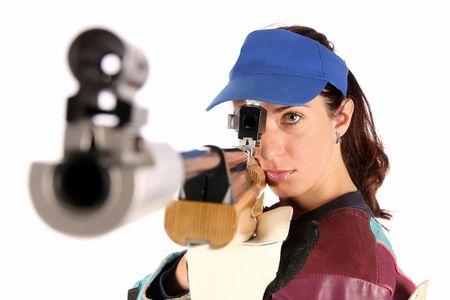 airgun: beautiful young woman aiming a pneumatic air rifle
