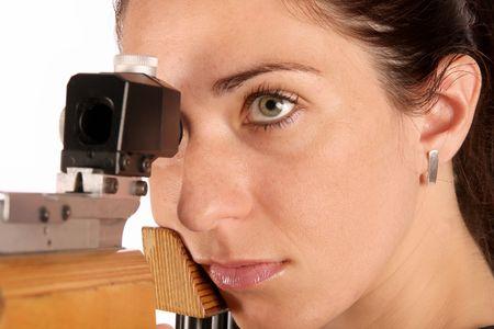 rifleman: beautiful young woman aiming a pneumatic air rifle