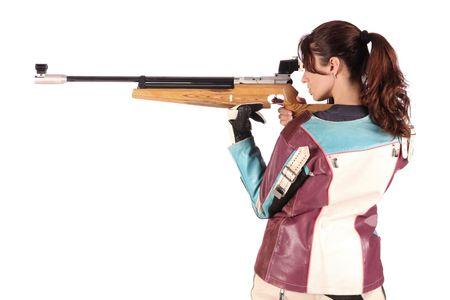 rifleman: hermosa mujer joven, con el objetivo de un rifle de aire de neum�tico Foto de archivo