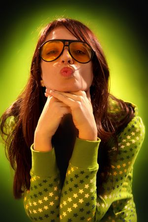 Beauty young woman sending kiss on dark background Stock Photo - 5830350
