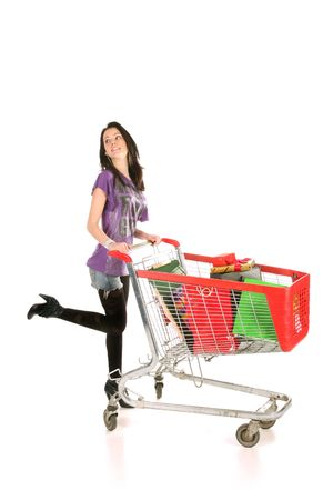 girl with shopping cart over white background Stock Photo
