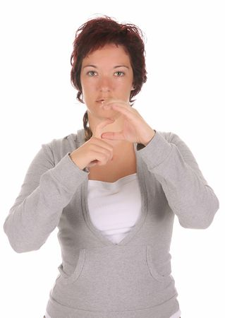 beauty young deaf person hand demonstrating, G in the alphabet of signs  photo