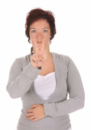 beauty young deaf person hand demonstrating, V in the alphabet of signs  photo