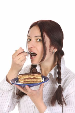 Beautiful woman eating piece of cake on white background Stock Photo - 6792055
