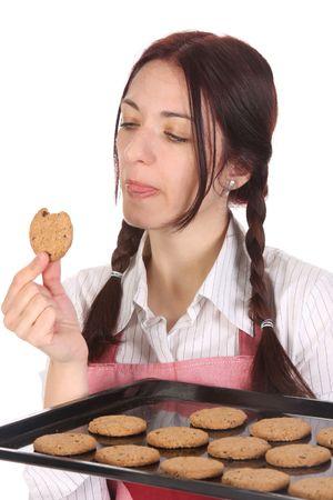beautiful housewife eating a slice of chocolate cake  photo