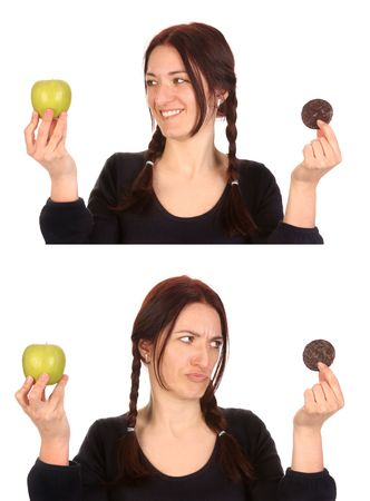 beautiful woman choosing between chocolate cookies and apple on white background  photo
