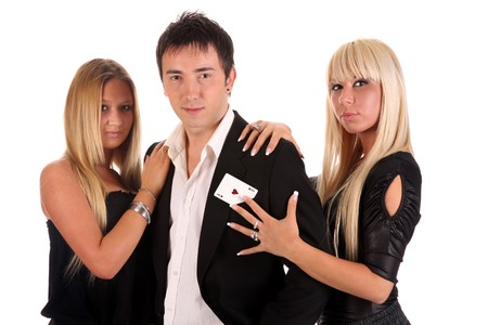 Magician performance with as heart card and two beauty girls photo