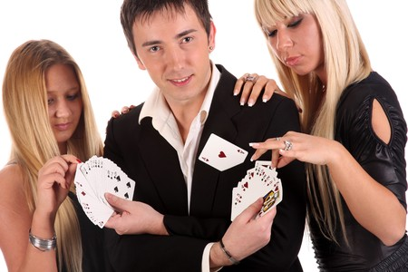 Magician make performance cards with two beauty girls photo