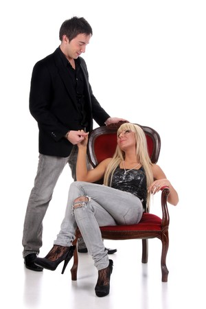 Young man and a woman sitting on a chair on white background photo
