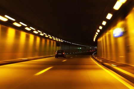 Car trails in motion through a tunnel  photo
